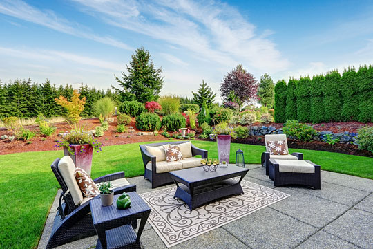 landscaped backyard with patio