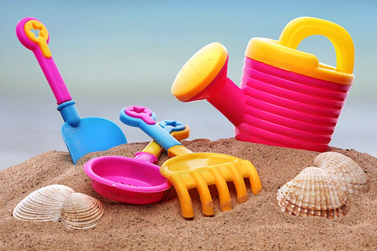 beach toys on a sandy beach