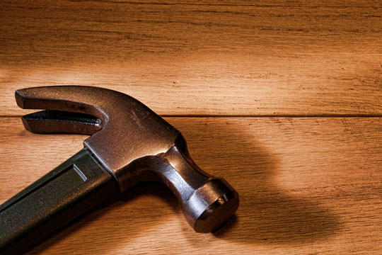 claw hammer on wood boards