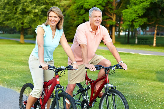 seniors cycling in a park