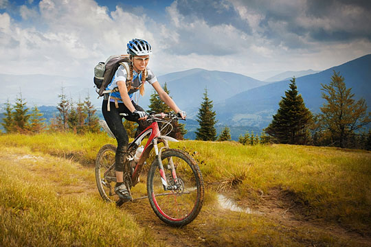 woman riding a mountain bike
