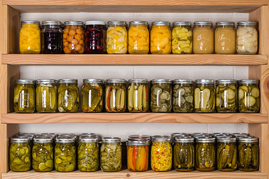 food storage shelves with homemade canned goods