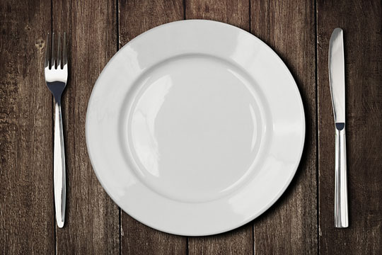 table with plate, knife, and fork
